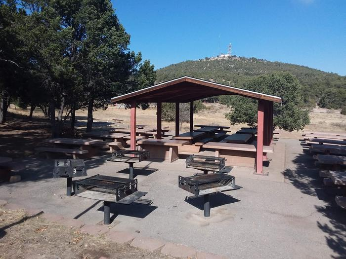Robin Pavilion with multiple grills and picnic tables as well as mountainous views