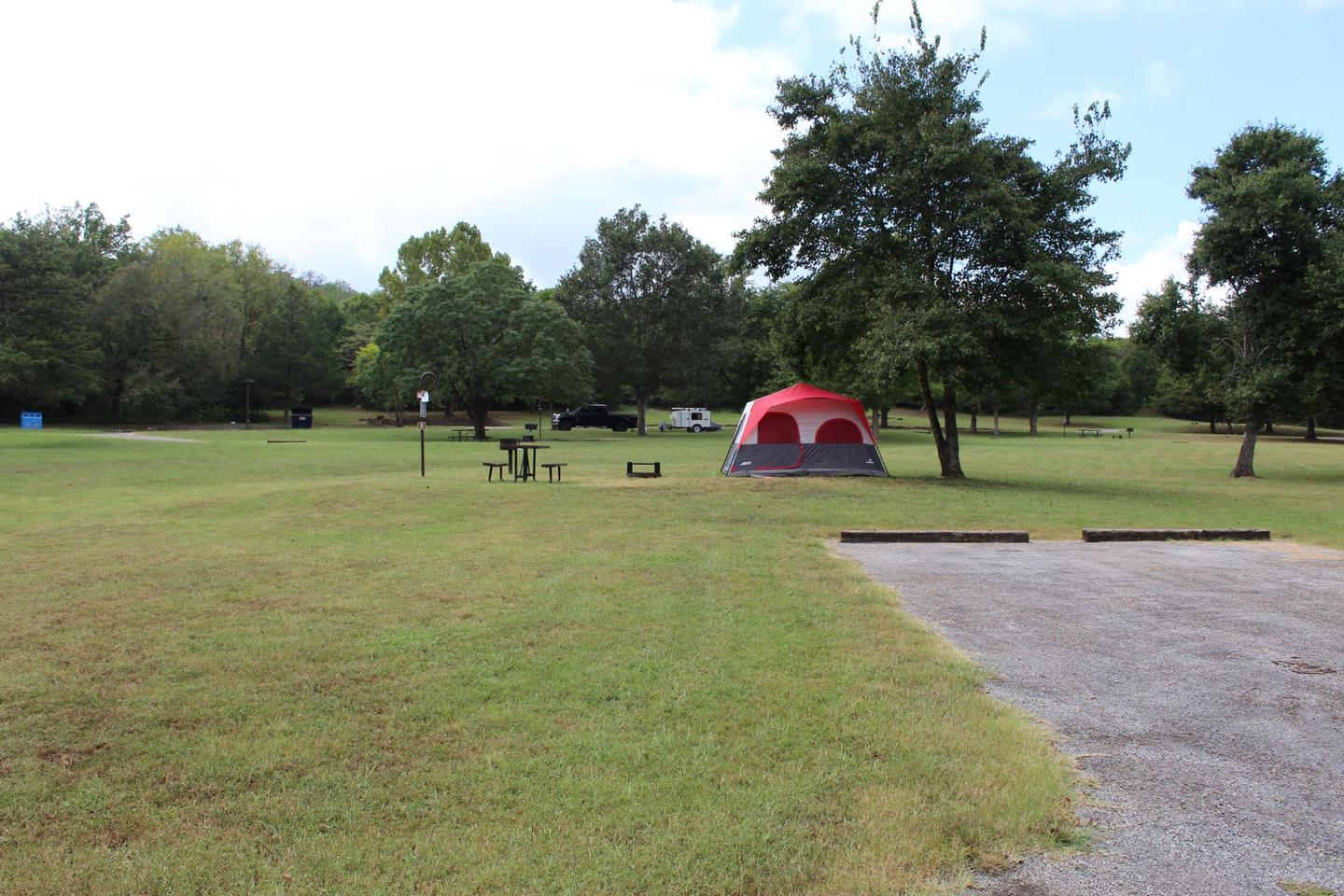 Tyler Bend Main Loop Site# 8-7 Site# 8, 35' back-in, tent pad 15' x 15'.  Parking area is wide enough to parking Rv & car side by side.