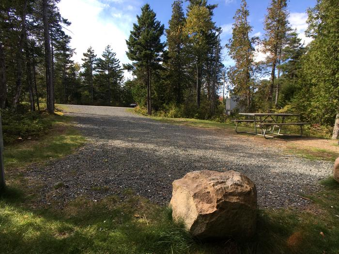 A photo of Site A09 As Viewed From The Rear of The SiteA photo of Site A09 of Loop A-Loop at Schoodic Woods Campground with Picnic Table, Electricity Hookup, Fire Pit