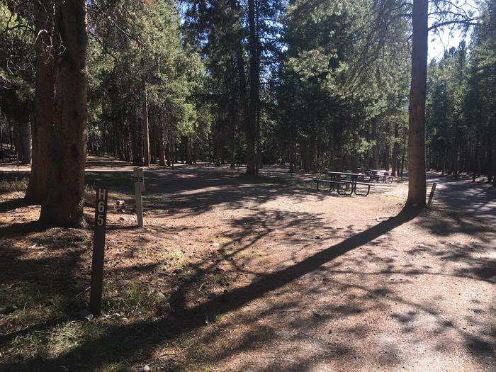 A photo of Site 65 of Loop H at Colter Bay RV Park with Full Hookup