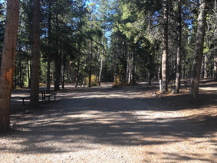 A photo of Site 104 of Loop N at Colter Bay RV Park with Full Hookup