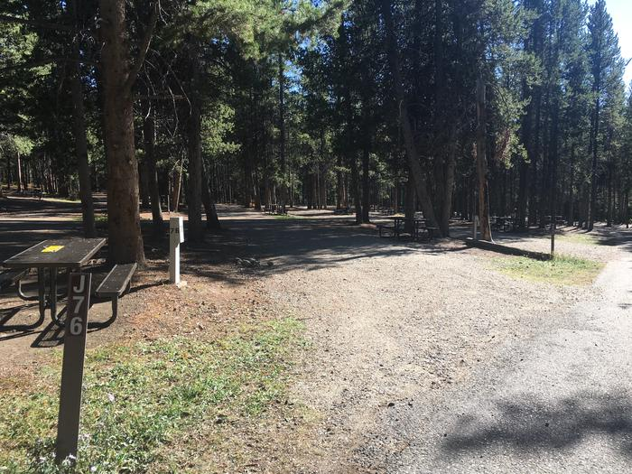 A photo of Site 76 of Loop J at Colter Bay RV Park with Full Hookup
