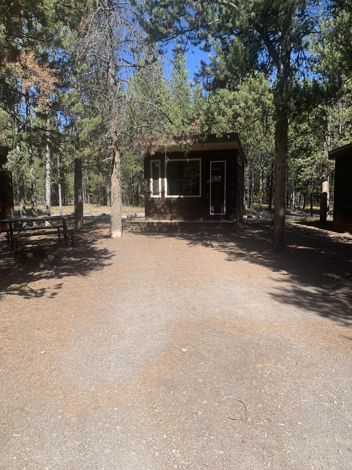 A photo of Site 110 of Loop 100s at Headwaters Campground at Flagg Ranch with Picnic Table, Fire Pit