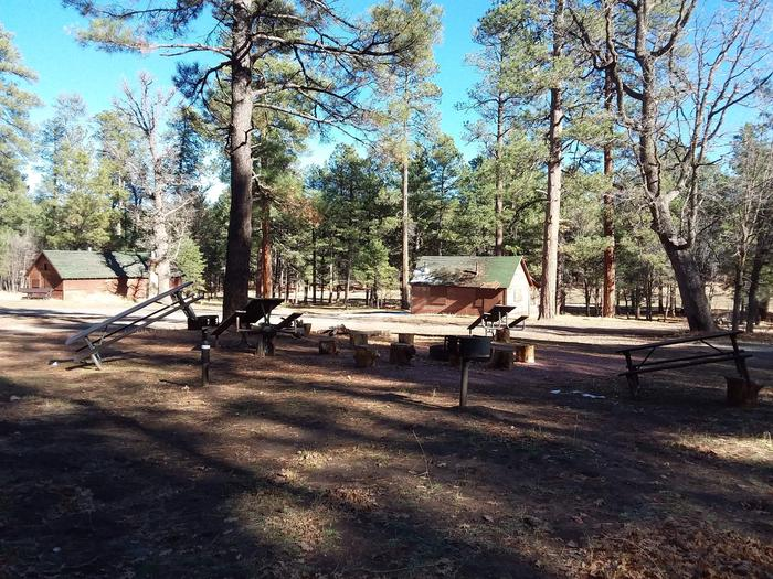 Long Valley Work Center Campground: group site structures and picnic tables, plus seatingLong Valley Group CG