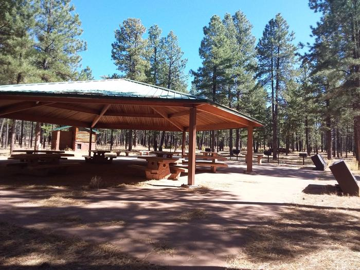 Group Campsite A with multiple grills and picnic tables, a pavilion and restrooms