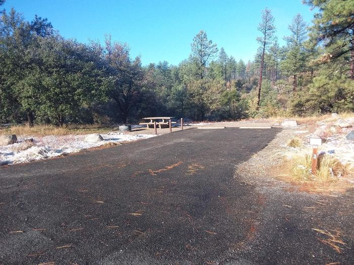 Campsite 03 with parking spaces, picnic table and fire pit