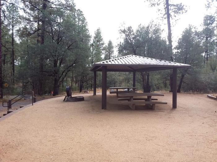 Lynx Campground Loop D Site 019:two tables and fire pit with a shade structureLynx Campground Loop D Site 019