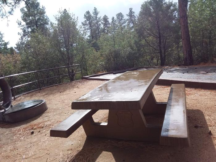 Lynx Campground Loop F Site 026: table and fire pit near paved parking.Lynx Campground Loop F Site 026