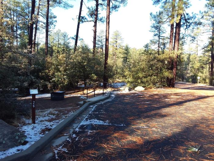 Campsite 26 with a picnic table, campfire ring and paved parking space