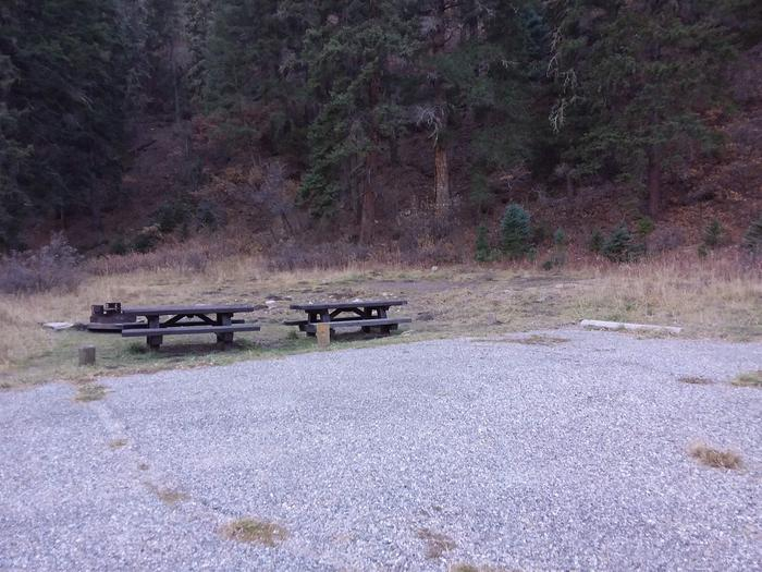 Site 19 with picnic tables, fire ring, and parking.