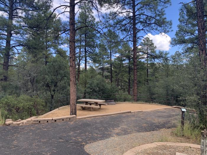 A photo of Site 26 of Loop F at LYNX CAMPGROUND with Picnic Table, Fire Pit with back-in parking.
