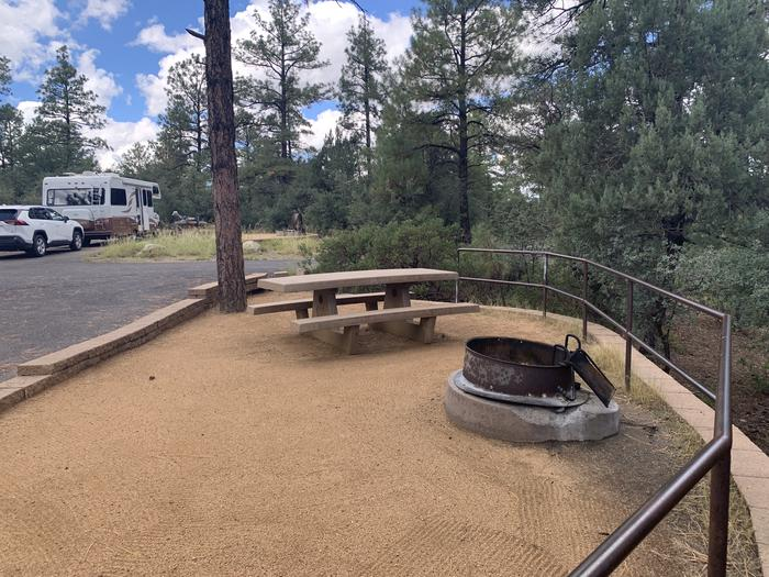 A photo of Site 26 of Loop F at LYNX CAMPGROUND with Picnic Table, Fire Pit. Site F25 in background.