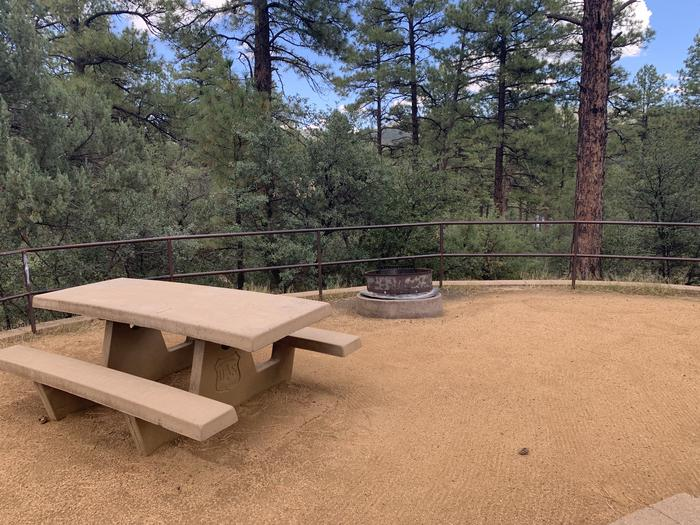 A photo of Site 26 of Loop F at LYNX CAMPGROUND with Picnic Table, Fire Pit
