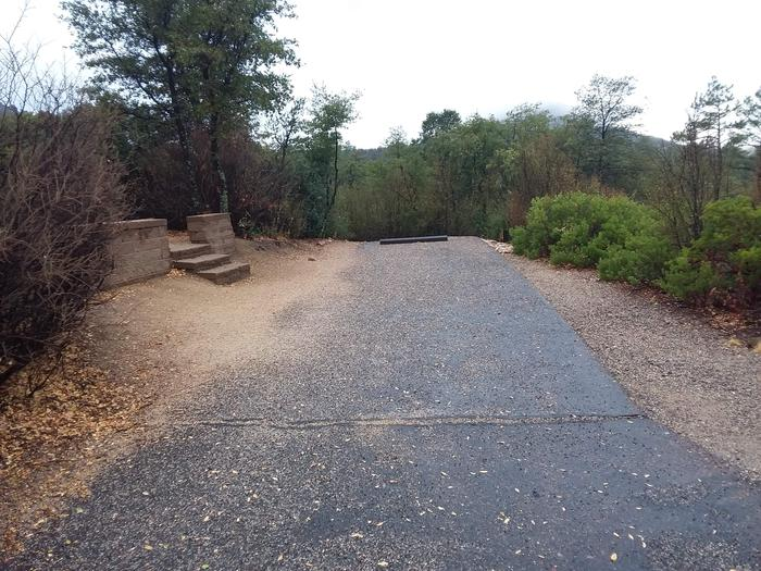 Yavapai Campsite 14 paved parking space with steps leading to the other site amenities