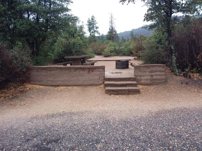 Yavapai Campsite 14 stone wall platform with a picnic table, fire ring and designated space for tent placement