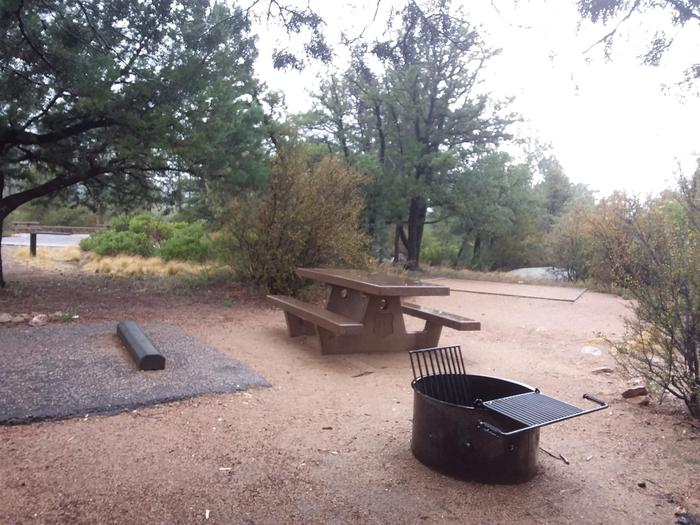 Yavapai Campsite 15 picnic table and fire ring with a designated space for tent placement in the background
