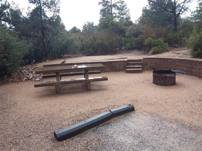 Yavapai Campsite 19 picnic table and fire ring as well as a designated space for tent placement in the background