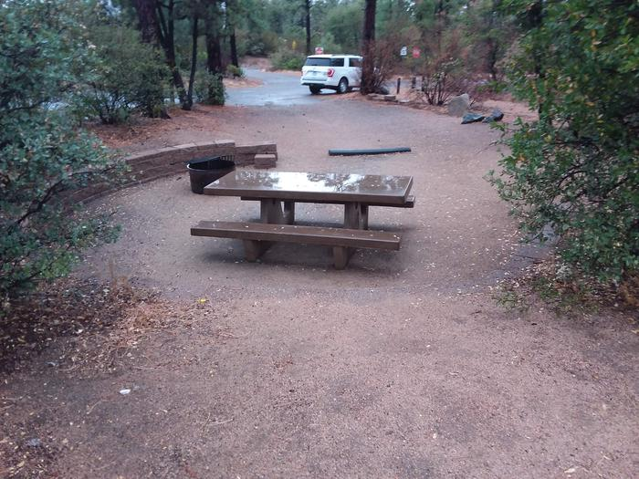 Yavapai Campsite 21 with a picnic table, fire ring and paved parking space