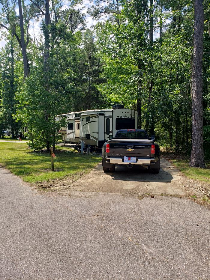 A photo of Site 004 of Loop CATOMA at GUNTER HILL with Picnic Table, Electricity Hookup, Sewer Hookup, Fire Pit, Shade, Full Hookup, Water Hookup