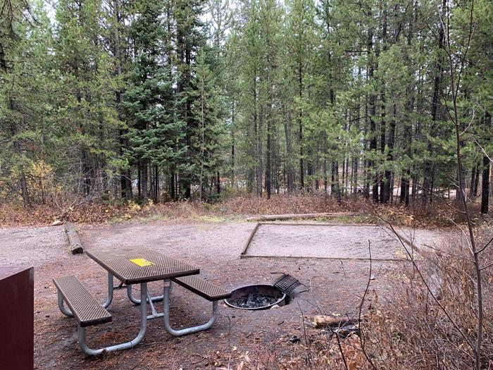 A photo of Site 20 of Loop 1 at Signal Mountain Lodge Campground with Picnic Table, Electricity Hookup, Fire Pit, Shade, Food Storage, Tent Pad