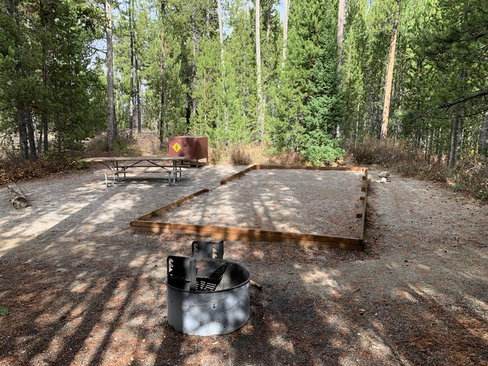 A photo of Site 18 of Loop 1 at Signal Mountain Lodge Campground with Picnic Table, Electricity Hookup, Fire Pit, Shade, Food Storage, Tent PadADA Accessible.