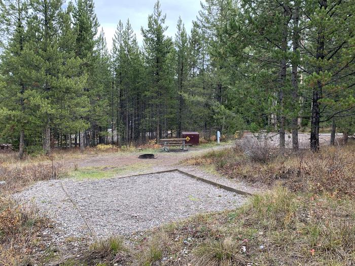 A photo of Site 33 of Loop 1 at Signal Mountain Lodge Campground with Picnic Table, Electricity Hookup, Fire Pit, Shade, Food Storage, Tent Pad