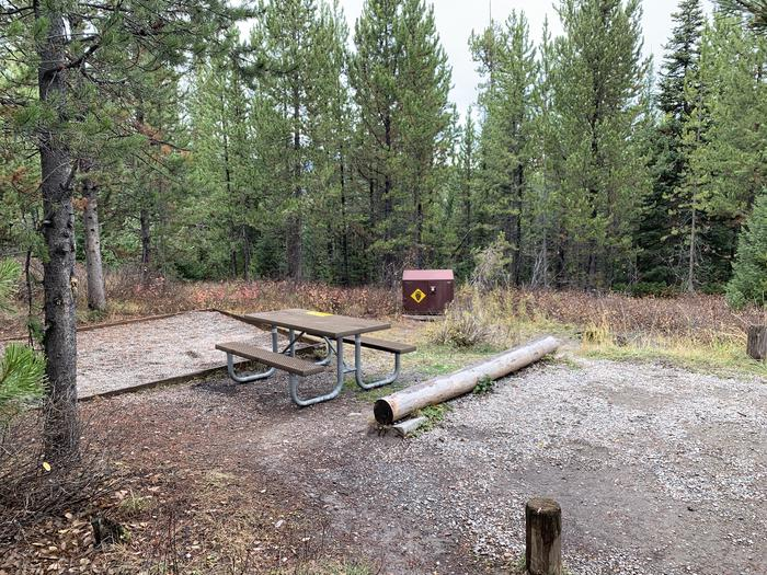 A photo of Site 34 of Loop 1 at Signal Mountain Lodge Campground with Picnic Table, Electricity Hookup, Fire Pit, Shade, Food Storage, Tent Pad