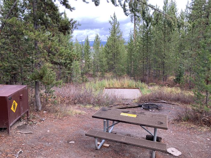 A photo of Site 13 of Loop 1 at Signal Mountain Lodge Campground with Picnic Table, Fire Pit, Shade, Food Storage, Tent Pad