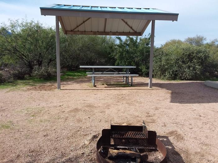 Site 3 with a picnic table, a fire ring, shade structure, and parking area.