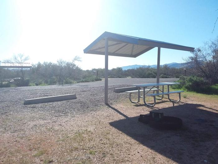 Site 96 with a picnic table, campfire ring, and a parking spot
