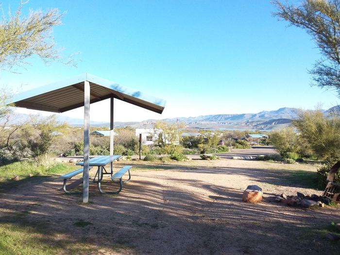 Site 165 with a picnic table, fire ring, shade structure, and parkingSite 165 with a picnic table, fire ring, shade structure, and parking.
