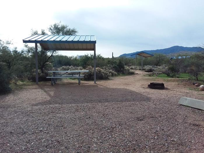 Site 168 with a picnic table, fire ring, shade structure, and parking.