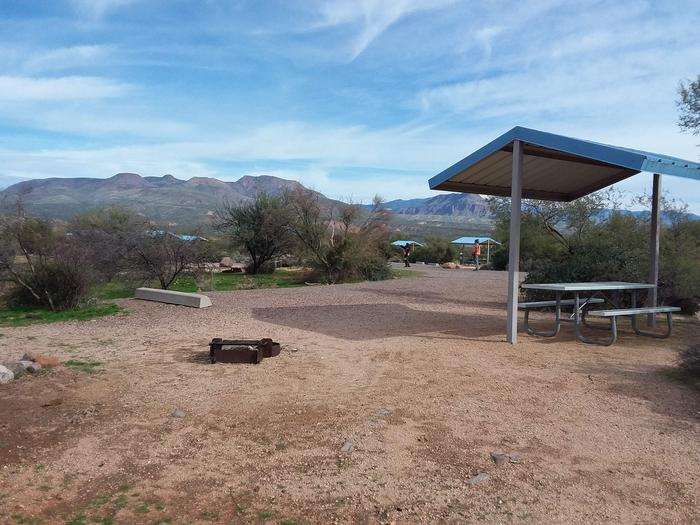 Site 168 with a picnic table, fire ring, shade structure, and parkingSite 168 with a picnic table, fire ring, shade structure, and parking.