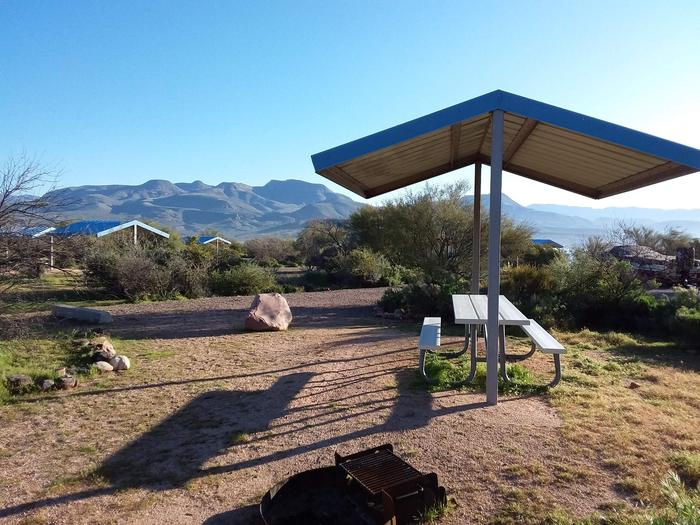 Site 170 with a picnic table, fire ring, shade structure, and parking.