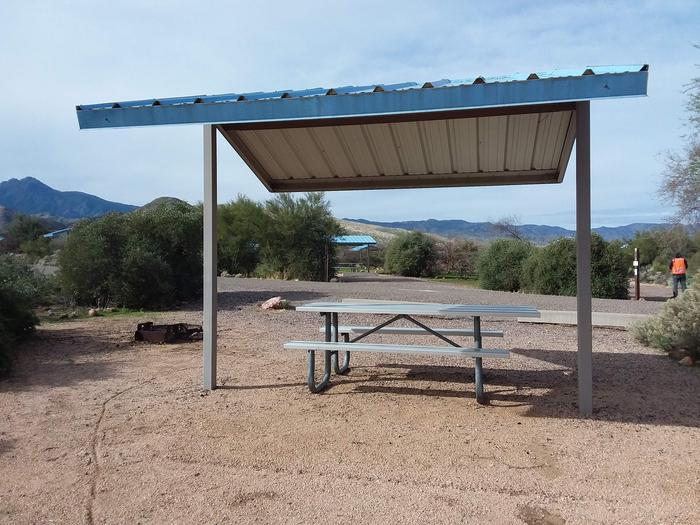 Site 172 with a picnic table, fire ring, shade structure, and parkingSite 172 with a picnic table, fire ring, shade structure, and parking.