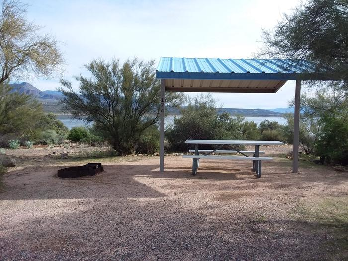 Site 174 with a picnic table, fire ring, shade structure, and parkingSite 174 with a picnic table, fire ring, shade structure, and parking.