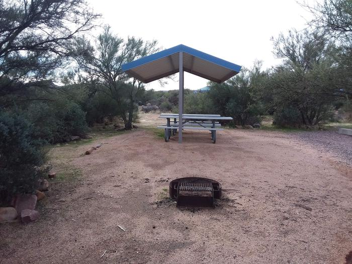 Site 178 with picnic tables, a fire ring, shade structure, and parkingSite 178 with picnic tables, a fire ring, shade structure, and parking.