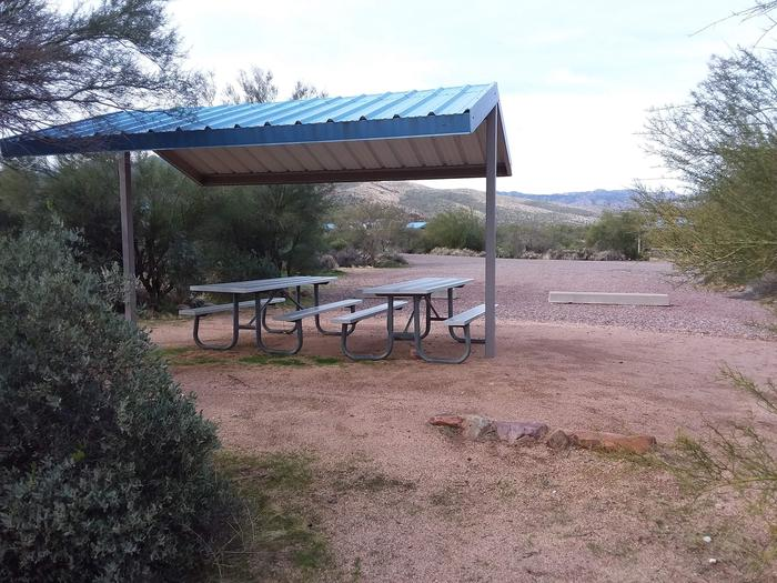 Site 178 with picnic tables, a fire ring, shade structure, and parking.