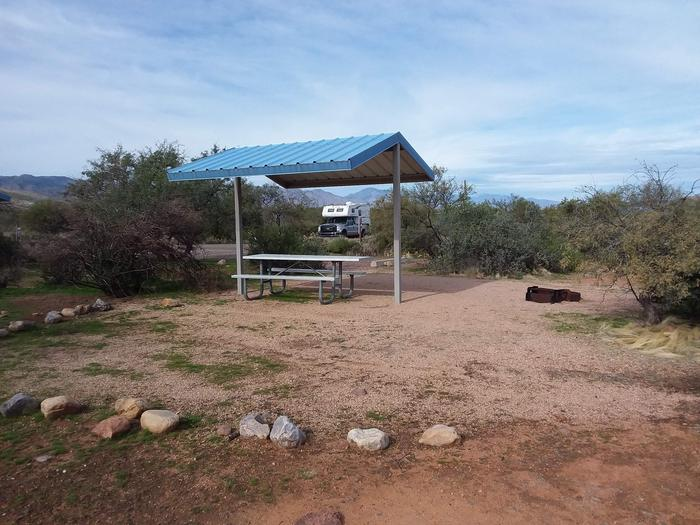 Site 182 with a picnic table, fire ring, shade structure, and parkingSite 182 with a picnic table, fire ring, shade structure, and parking.