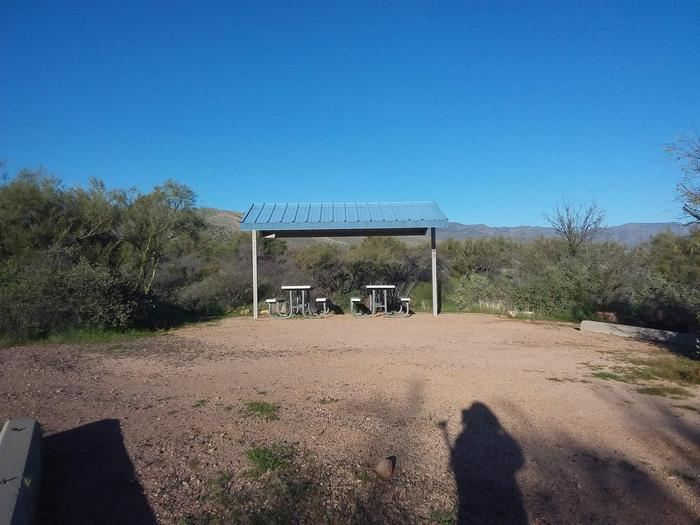 Site 183 with picnic tables, a fire ring, shade structure, and parkingSite 183 with picnic tables, a fire ring, shade structure, and parking.
