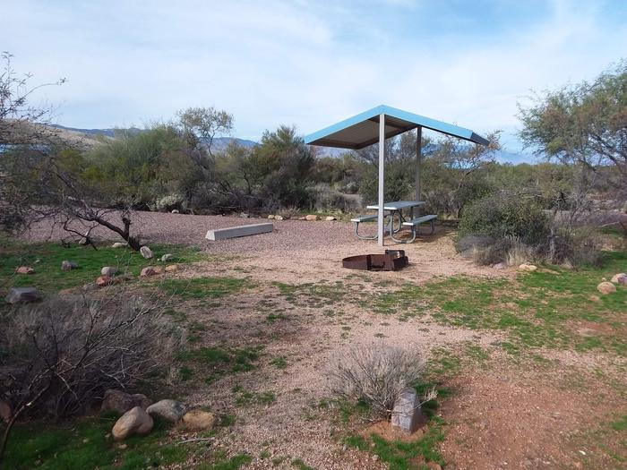 Site 186 with a picnic table, fire ring, shade structure, and parkingSite 186 with a picnic table, fire ring, shade structure, and parking.