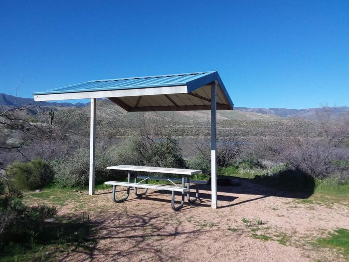 Site T10 with a picnic table, fire ring, shade structure, and parkingSite T10 with a picnic table, fire ring, shade structure, and parking.