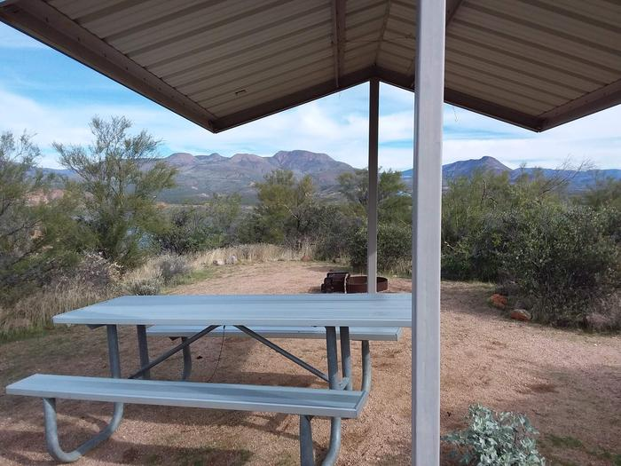 Campsite T15, Cane Loop with a picnic table, fire ring, shade structure, and parking.