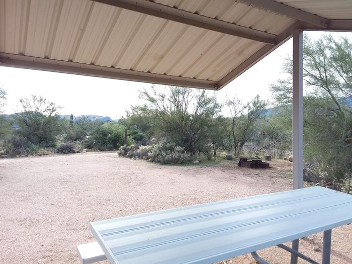 Site T16 with a picnic table, fire ring, shade structure, and parkingSite T16 with a picnic table, fire ring, shade structure, and parking.