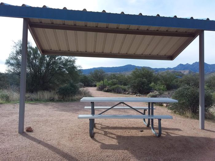 Site T18 with a picnic table, fire ring, shade structure, and parkingSite T18 with a picnic table, fire ring, shade structure, and parking.