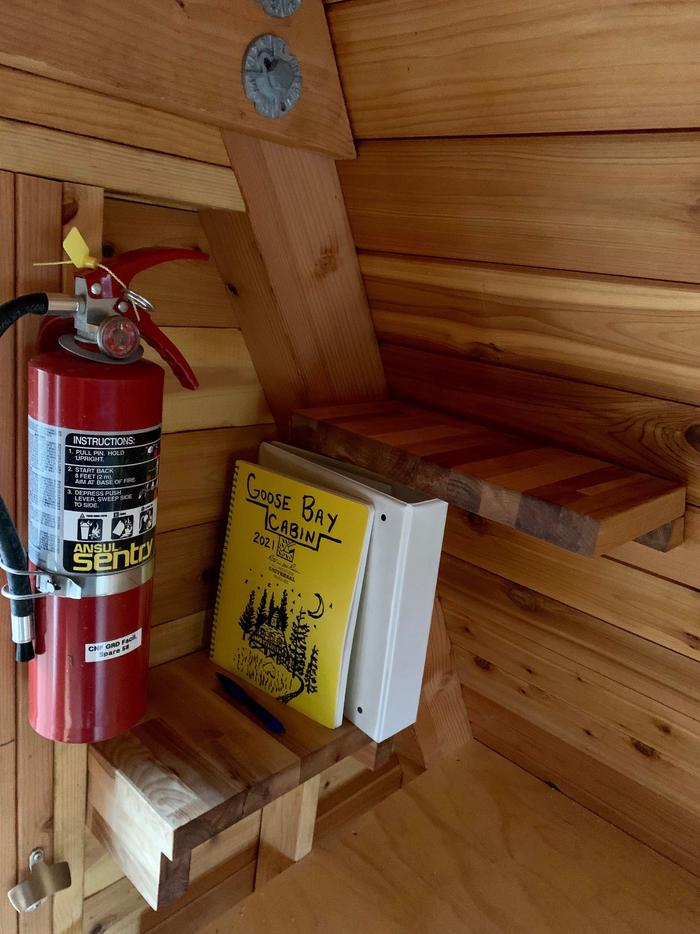 Goose Bay Cabin - Shelves and fire extinguisherShelves and fire extinguisher