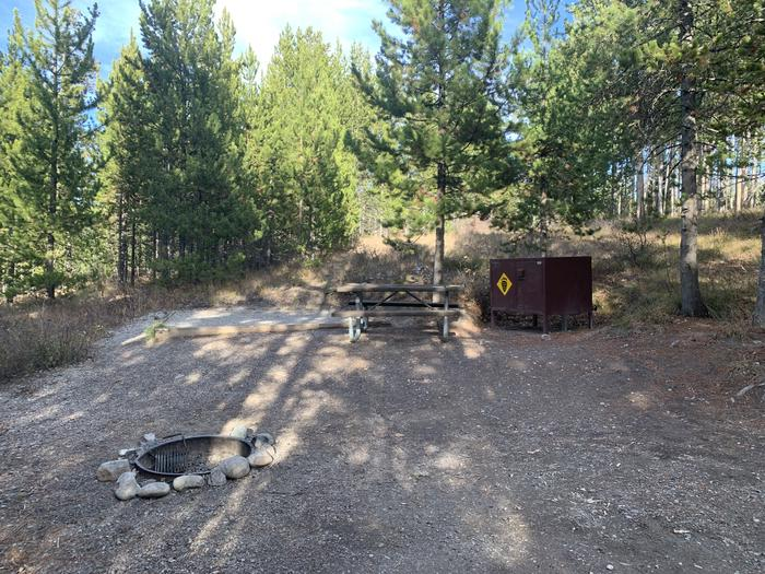 A photo of Site 26 of Loop 1 at Signal Mountain Lodge Campground with Picnic Table, Fire Pit, Shade, Food Storage, Tent Pad