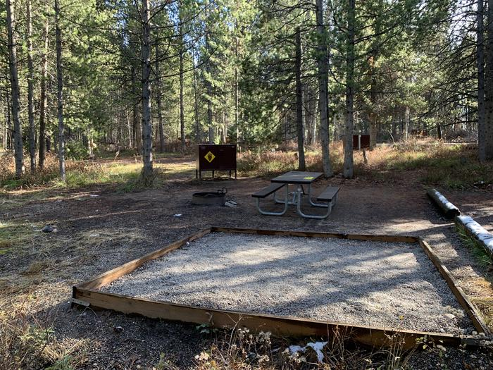 A photo of Site 47 of Loop 2 at Signal Mountain Lodge Campground with Picnic Table, Fire Pit, Shade, Food Storage, Tent Pad
