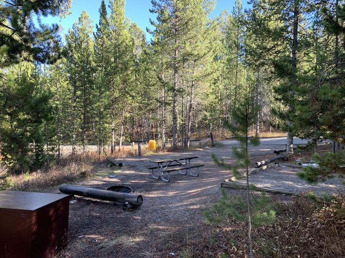 A photo of Site 14 of Loop 1 at Signal Mountain Lodge Campground with Picnic Table, Fire Pit, Shade, Food Storage, Tent Pad