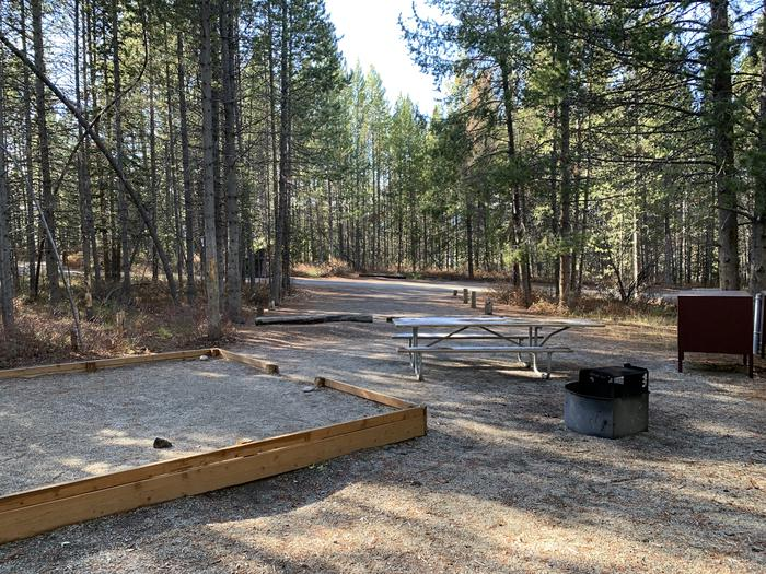 A photo of Site 46 of Loop 2 at Signal Mountain Lodge Campground with Picnic Table, Fire Pit, Shade, Food Storage, Tent PadADA Accessible.